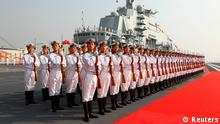 Naval honour guards stand as they wait for a review on China's aircraft carrier Liaoning in Dalian, Liaoning province, September 25, 2012. China's first aircraft carrier was delivered and commissioned to the Navy of the Chinese People's Liberation Army on Tuesday after years of refitting and sea trials. REUTERS/Xinhua/Zha Chunming (CHINA - Tags: MILITARY POLITICS) NO SALES. NO ARCHIVES. FOR EDITORIAL USE ONLY. NOT FOR SALE FOR MARKETING OR ADVERTISING CAMPAIGNS. THIS IMAGE HAS BEEN SUPPLIED BY A THIRD PARTY. IT IS DISTRIBUTED, EXACTLY AS RECEIVED BY REUTERS, AS A SERVICE TO CLIENTS. CHINA OUT. NO COMMERCIAL OR EDITORIAL SALES IN CHINA. YES