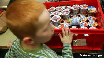 WUPPERTAL, GERMANY - MAY 30: A child picks up a joghurt at the Wuppertal Tafel on May 30, 2008 in Wuppertal-Barmen, Germany. Unicef, United Nation's Children's Fund reports an alarming increase of child poverty in Germany by 2,7 per cent from 1990 on. (Photo by Christof Koepsel/Getty Images)