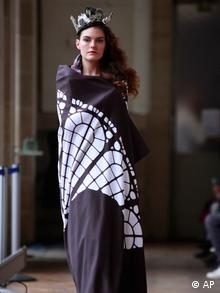 A model shows a creation by French fashion designer Karim Bonnet as part of Impasse de la Defense ready to wear Spring-Summer 2013 collection, presented in Paris, Tuesday, Sept.25, 2012. (Foto:Thibault Camus/AP/dapd)