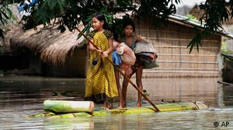 Flood affected children pole a raft in Burhabrhi village about 65 kilometers (41 miles) east of Gauhati, Assam state, India (Photo: Anupam Nath/ AP/ dapd)