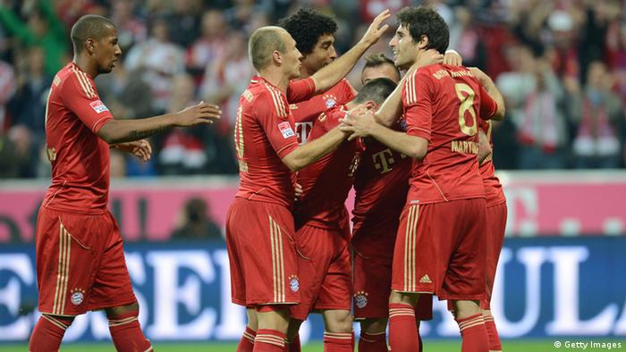 GettyImages 152762352 (From L) Bayern Munich's defender Jerome Boateng, Bayern Munich's Dutch midfielder Arjen Robben, Bayern Munich's Brazil defender Dante, Bayern Munich's French midfielder Franck Ribery, Bayern Munich's Swiss midfielder Xherdan Shaqiri, Bayern Munich's Spain midfielder Javi Martinez and Bayern Munich's Croatian striker Mario Mandzukic celebrate during the German first division Bundesliga football match FC Bayern Munich vs Vfl Wolfsburg in Munich, southern Germany, on September 25, 2012. AFP PHOTO / CHRISTOF STACHE RESTRICTIONS / EMBARGO - DFL RULES TO LIMIT THE ONLINE USAGE DURING MATCH TIME TO 15 PICTURES PER MATCH. IMAGE SEQUENCES TO SIMULATE VIDEO IS NOT ALLOWED AT ANY TIME. FOR FURTHER QUERIES PLEASE CONTACT DFL DIRECTLY AT + 49 69 650050. (Photo credit should read CHRISTOF STACHE/AFP/GettyImages)