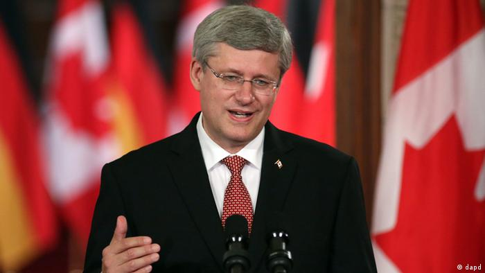 Canadian Prime Minister Stephen Harper speaks at a joint press conference with German Chancellor Angela Merkel on Parliament Hill in Ottawa, Canada, Thursday, Aug. 16, 2012. (AP Photo/The Canadian Press,Patrick Doyle)