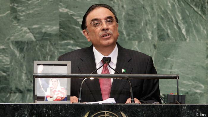 Pakistani President Asif Ali Zardari, addresses the 67th session of the United Nations General Assembly with a photo of Pakistan's late Prime Minister Benazir Bhutto next to him at UN headquarters Tuesday, September 25, 2012