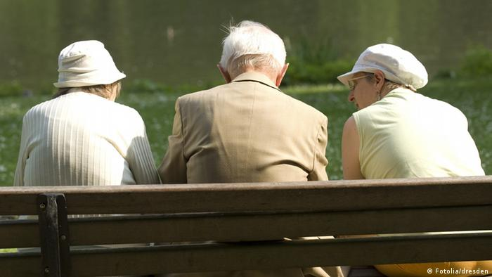 Three senior citizens sitting on a bench