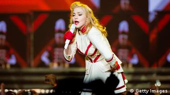 Madonna performs on stage Photo by Jeff Fusco/Getty Images