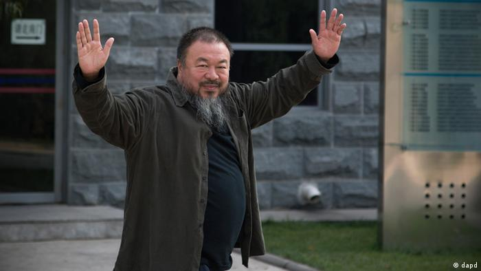 Chinese Activist artist Ai Weiwei waves to journalists as he arrives to the Beijing No. 2 People's Intermediate Court in Beijing Thursday, Sept. 27, 2012; Photo: AP Photo/Andy Wong
