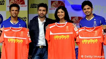 Indian cricketer Rahul Dravid (L), Raj Kundra and his wife Indian Bollywood actress Shilpa Shetty and cricketer Sreesant unveil the IPL 2012 Rajsthan Royals' jersey in Mumbai on March 5, 2012 (Photo: STRDEL/AFP/Getty Images)