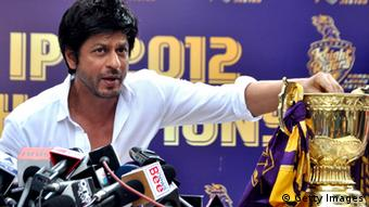 Shah Rukh Khan, pictured with the Indian Premier League trophy, addresses a press conference in Mumbai on May 30, 2012 (Photo: STRDEL/AFP/GettyImages)