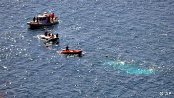 Coast guards search for survivors after at least 58 illegal immigrants drowned when a fishing boat carrying people who had been promised refuge in Europe sank after hitting rocks off the coast near Aegean city of Izmir, Turkey, Thursday, Sept. 6, 2012. (Hurriyet/AP/dapd)