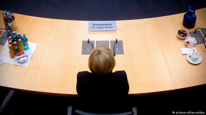 German Chancellor, pictured from above, waits for questions from the investigative parliamentary committee in Berlin.
