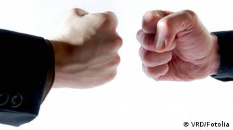 Picture of two fists opposite each other.#21187750 © VRD - Fotolia.com