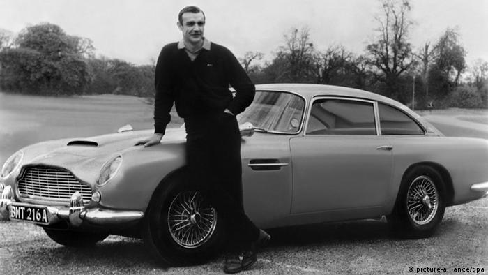 Астон Мартин печели световна слава именно благодарение на поредицата за Джеймс Бонд. Във филмите автомобилът е оборудван с най-причудливи технически нововъведения, като например седалка с катапулт. В Голдфингър Шон Конъри кара Астон Мартин DB5, който се появява и в Скайфол с Даниел Крейг. Във филма Спектър Крейг седи зад волана на новия Астон Мартин DB10.
