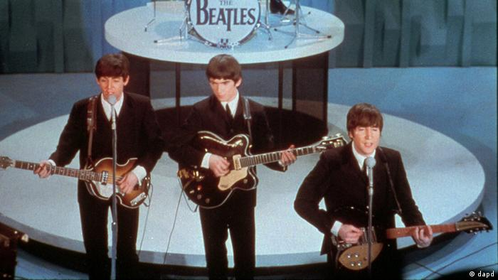 FILE - In this Feb. 9, 1964 file photo, The Beatles, front row from left, Paul McCartney, George Harrison, John Lennon and Ringo Starr on drums, perform at the Ed Sullivan Show, in New York. BlueBeat.com has agreed to pay $950,000 to settle a lawsuit filed by the music companies EMI, Capitol Records and Virgin Records America after posting digital copies of The Beatles music a year before they became legitimately available. (AP Photo, file)