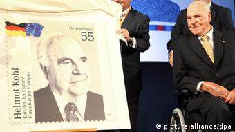 Former Chancellor Helmut Kohl and a stamp bearing his image.