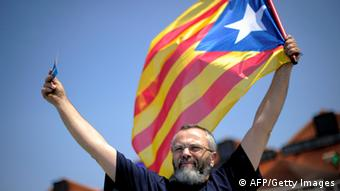 A man holds a Catalan flag during a protest Photo: JOSEP LAGO/AFP/GettyImages