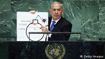 NEW YORK, NY - SEPTEMBER 27: Benjamin Netanyahu, Prime Minister of Israel, pauses after drawing a red line on a graphic of a bomb while discussing Iran during an address to the United Nations General Assembly on September 27, 2012 in New York City. The 67th annual event gathers more than 100 heads of state and government for high level meetings on nuclear safety, regional conflicts, health and nutrition and environment issues. (Photo by Mario Tama/Getty Images)
