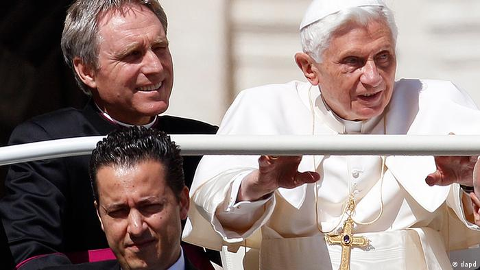 File photo taken Wednesday, May 2, 2012, Pope Benedict XVI arrives in St. Peter's square at the Vatican for a general audience as his butler Paolo Gabriele, bottom, and his personal secretary Georg Gaenswein sit in the car with him. Photo:Alessandra Tarantino, File/AP/dapd