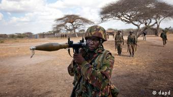A Kenyan army soldier carries a rocket-propelled grenade launcher as he patrols in Tabda, inside Somalia (AP Photo/Ben Curtis, File)