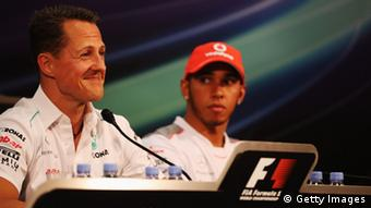 MONTE CARLO, MONACO - MAY 23: Lewis Hamilton (R) of Great Britain and McLaren listens as Michael Schumacher (L) of Germany and Mercedes GP talks at the drivers press conference during previews to the Monaco Formula One Grand Prix (Photo: Getty Imgaes)
