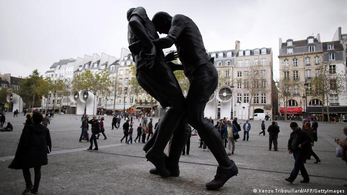 A picture taken on September 27, 2012 in Paris shows a bronze sculpture by Algerian artist Adel Abdessemed displayed in front of the Centre Pompidou contemporary art center, aka Beaubourg. The sculpture immortalizes the 'headbutt' given by the French former football champion Zinedine Zidane to Italian player Materazzi during the World Cup final in 2006. The Centre Pompidou will dedicate a retrospective to Abdessemed from October 3, 2012 to January 7, 2013. AFP PHOTO KENZO TRIBOUILLARD (Photo credit should read KENZO TRIBOUILLARD/AFP/GettyImages)