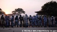 A line of Ugandan riot police is pictured as they clash with opposition supporters in the Namungoona suburb of Kampala, Uganda on January 24, 2012. Ugandan security personnel tried to detain opposition leader Kizza Besigye following a protest rally against rising living costs. AFP PHOTO/Michele Sibiloni (Photo credit should read MICHELE SIBILONI/AFP/Getty Images)
