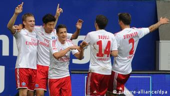 Hamburg players celebrate a goal in their game versus Hannover