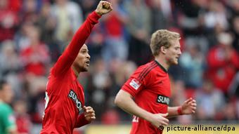 Sidney Sam and Andre Schürrle celebrate Leverkusen's opening goal against Greuther Fürth