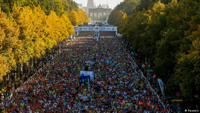 Source News Feed: EMEA Picture Service ,Germany Picture Service Runners compete in the 39th Berlin Marathon in Berlin, September 30, 2012. Pictured in the background is the Brandenburg Gate. REUTERS/Thomas Peter (GERMANY - Tags: SPORT ATHLETICS)