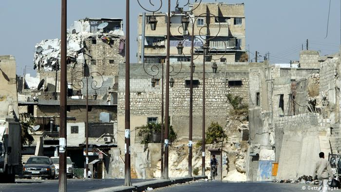 A picture taken on September 28, 2012 shows damaged buildings in the northern city of Aleppo following months of clashes and battles between Syrian rebels and government forces. AFP PHOTO/MIGUEL MEDINA (Photo credit should read MIGUEL MEDINA/AFP/GettyImages)