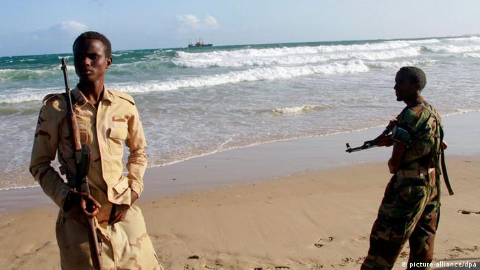 epa03380432 A photograph dated 01 September 2012 and made available on 02 September 2012 shows Somali government soldiers standing guard at a beach in Marka, Somalia. African Union forces said the troops seized the port town of Marka from al-Shabab on 27 August 2012. The loss of Marka, some 80km south of the capital Mogadishu, is another blow for al-Shabab and leaves the militants in control of two more ports in southern Somalia, Kismayo and Barawe. EPA/ELYAS AHMED