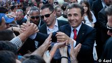 Georgia's billionaire and opposition leader Bidzina Ivanishvili, right, mingles with his supporters during a rally (photo: AP Photo/Georgy Abdaladze)