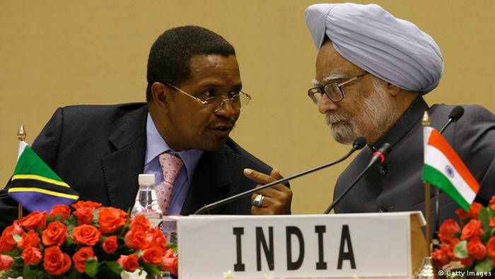 Indian Prime Minister Manmohan Singh (R) listens as Tanzanian President and African Union President Jakaya Mrisho Kikwete speaks during the first India-Africa Forum Summit in New Delhi on April 9, 2008. India sought to deepen strategic and economic ties with resource-rich Africa as it held its first summit meeting with African leaders and sweetened the pot by offering financial help.Indian Premier Manmohan Singh, playing host to the presidents of five African states and senior leaders of nine other countries, announced export tariffs cuts that he said would benefit 34 of Africa's 53 countries. AFP PHOTO/Findlay KEMBER (Photo credit should read FINDLAY KEMBER/AFP/Getty Images)