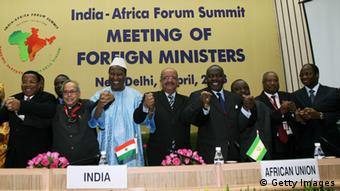 Indian Minister of Foreign Affairs Pranab Mukherjee (2L) holds hands with African Foreign Ministers during an India-Africa Forum Summit in New Delhi on April 7, 2008. The relationship between India and the 54-nation Africa is set to be redefined with the two sides expected to come out with a vision document outlining ways to boost engagement, particularly in the areas of economy and security at a two-day Summit in New Delhi beginning on April 8. The India-Africa Forum Summit, to be inaugurated by Prime Minister Manmohan Singh, will involve 'brainstorming' sessions between the leaders of the two sides, exploring how partnership in various fields could be enhanced. AFP PHOTO/RAVEENDRAN (Photo credit should read RAVEENDRAN/AFP/Getty Images)