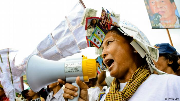 A woman shouts into a megahone during a protest in Phnom Penh Photo: Irwin Loy October 1 2012, Phnom Penh