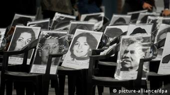 Argentine activists holding photos of some of the disappeared