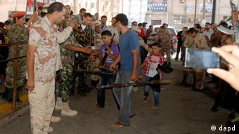 Libyan civilians turn in weapons to security forces in Benghazi Photo:Ibrahim Alaguri/AP/dapd