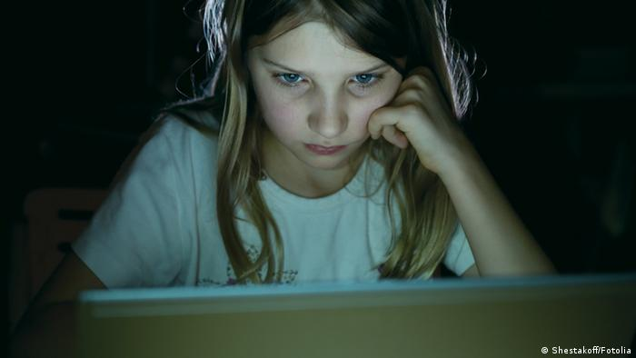 young person in front of computer screen
