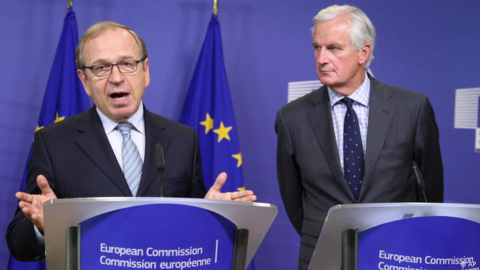 European Commissioner for Internal Market and Services Michel Barnier, right, and Erkki Liikanen, Member of the Governing Council of the European Central Bank