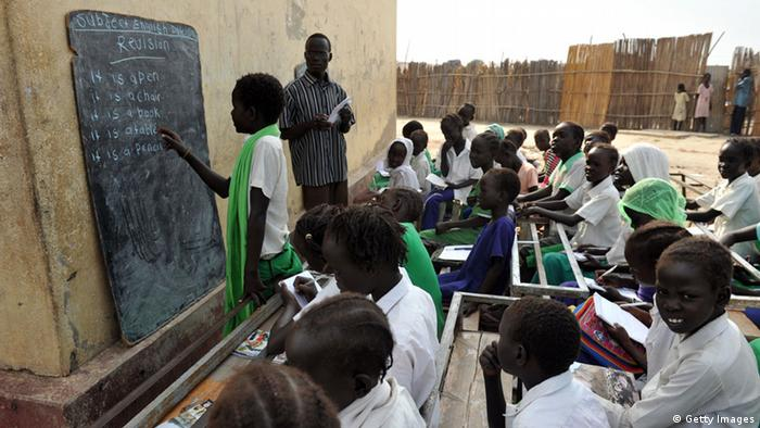 GettyImages 108017892 Students take part in an English class at a government school in Bentiu on November 13, 2011. Organisers of a landmark south Sudan independence vote confirmed January 13, 2010 the turnout threshold needed for it to be valid has been reached as ex-US president Jimmy Carter said the region looked set for nationhood. Drivers honked their horns in the regional capital Juba as southerners hailed the turnout achievement in just four days of the week-long period saying it showed the importance of freedom to them after five decades of conflict with the north.AFP PHOTO/ROBERTO SCHMIDT (Photo credit should read ROBERTO SCHMIDT/AFP/Getty Images)