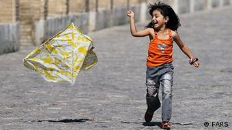 Young girl with kite Photo: FARS