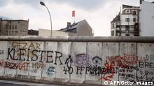 Various graffiti are painted on the Berlin Wall on the West Berlin side on April 29, 1984. The Berlin wall built by the East German government to seal off East Berlin from the part of the city occupied by the three main western powers (USA, Great Britain and France), and to prevent mass illegal emigration to the West. The wall, built along the border between German Democratic Republic (GDR) and Federal Republic of Germany, was the scene of the shooting of many East Germans who tried to escape from GDR. The two countries remained divided until November 1989 when the wall was unexpectedly opened following increased pressure for political reform in GDR. (Photo credit should read JOEL ROBINE/AFP/Getty Images)