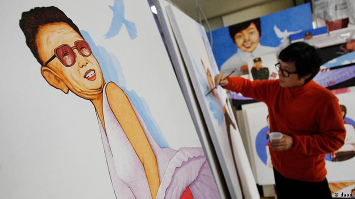 Song Byeok touches up some of his recent work in his studio in Seoul, South Korea. Photo: AP Photo/Wally Santana