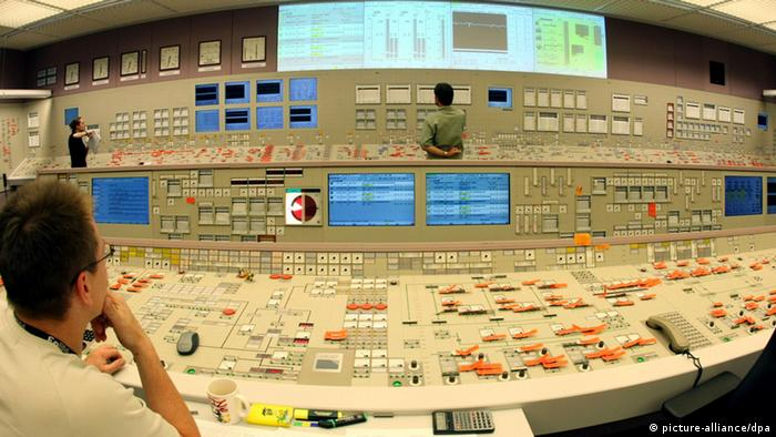 Archive image: An employee sits at a large console at the Philippsburg II nuclear power plant near Karslruhe in Germany's southwest. (picture-alliance/dpa)