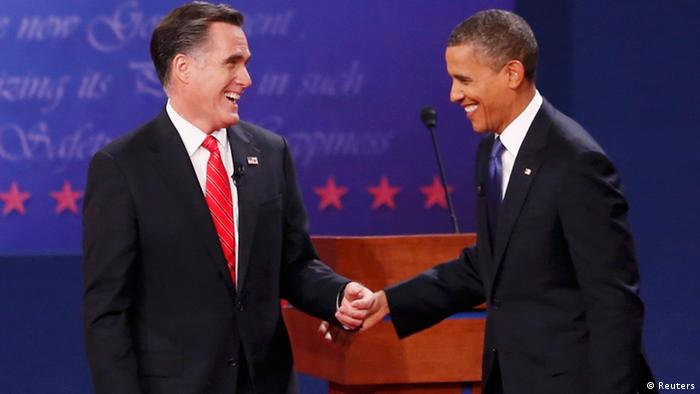 President Barack Obama (R) and Republican presidential nominee Mitt Romney share a laugh at the end of the first presidential debate in Denver October 3, 2012. REUTERS/Kevin Lamarque