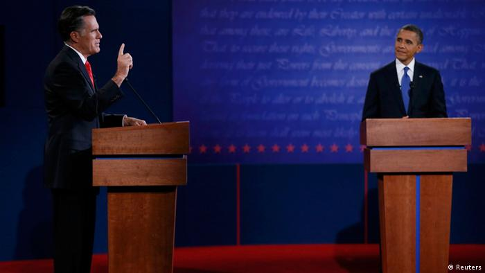 Republican presidential nominee Mitt Romney answers a question as U.S. President Barack Obama listens