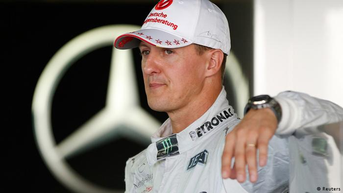 Mercedes Formula One driver Michael Schumacher of Germany stands in his garage at the Suzuka circuit October 4, 2012, ahead of Sunday's Japanese F1 Grand Prix. REUTERS/Toru Hanai (JAPAN)