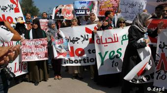 Moroccan women protest the scheduled arrival of a Dutch ship advocating safe and legal abortions in Smir, Their signs read no to abortion (Photo:Paul Schemm)