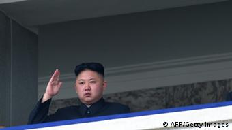 North Korean leader Kim Jong-Un salutes as he watches a military parade to mark 100 years since the birth of the country's founder and his grandfather, Kim Il-Sung, in Pyongyang on April 15, 2012. The commemorations came just two days after a satellite launch timed to mark the centenary fizzled out embarrassingly when the rocket apparently exploded within minutes of blastoff and plunged into the sea. AFP PHOTO / Ed Jones (Photo credit should read Ed Jones/AFP/Getty Images)