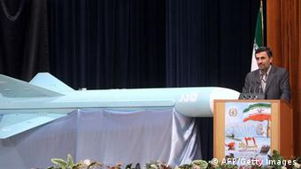 RESTRICTED TO EDITORIAL USE - MANDATORY CREDIT 'AFP PHOTO / HO / PRESIDENT.IR' - NO MARKETING NO ADVERTISING CAMPAIGNS - DISTRIBUTED AS A SERVICE TO CLIENTS A picture released by the official website of the Iranian president's office shows Iranian President Mahmoud Ahmadinejad delivering a speech next to the newly-unveiled 'Qader (Able)' missile, a marine-cruise missile with a 200 kilometre range, during a ceremony to mark Iran's annual 'Defence Industry Day' in Tehran on August 23, 2011. AFP PHOTO/IRANIAN PRESIDENT'S OFFICE (Photo credit should read -/AFP/Getty Images)