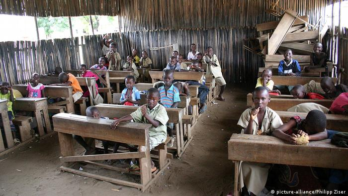 African students sitting in an improvised classroom.